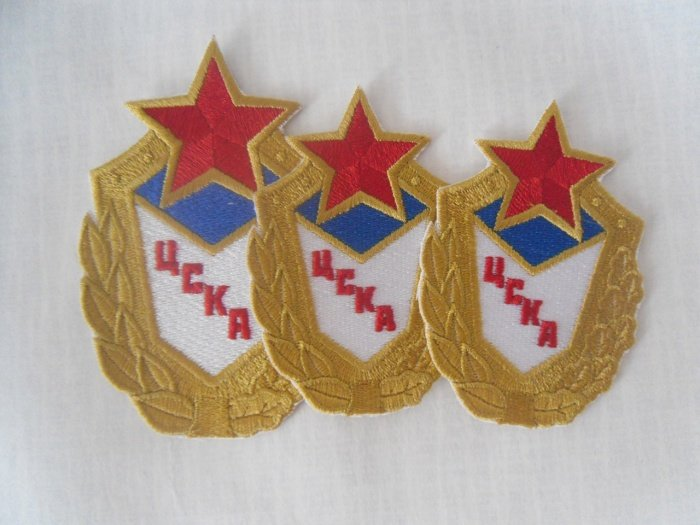 Вышивка логотипов спортивных клубов на футболках и бейсболках